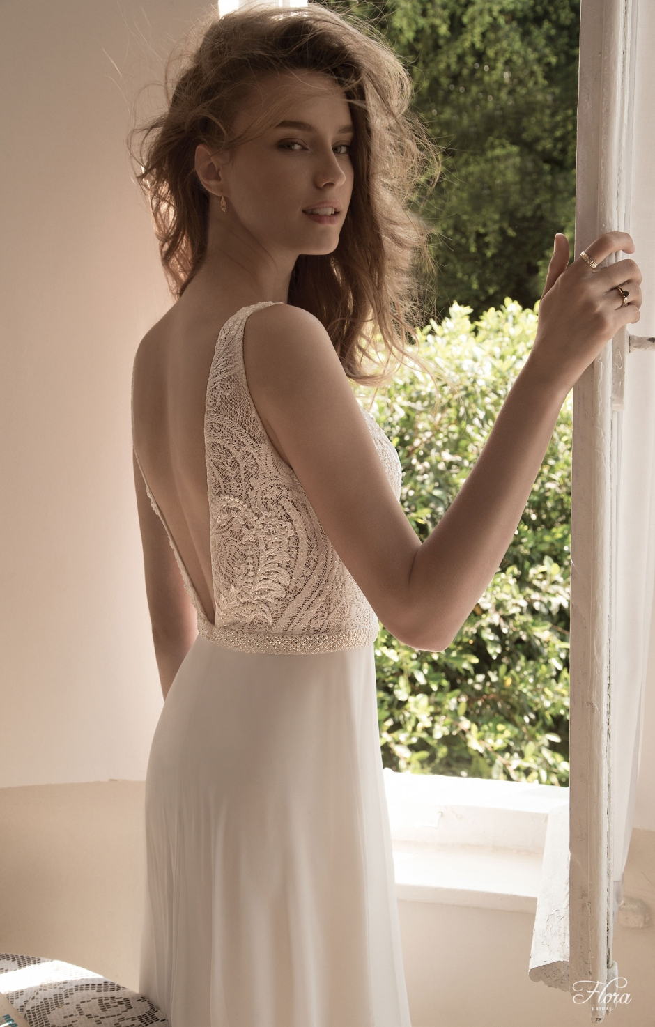 Back view of Nina wedding dress by flora bridal