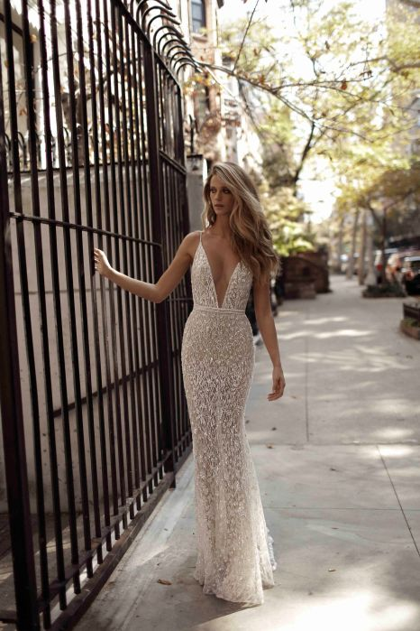Plunging neckline wedding dress by Berta Bridal