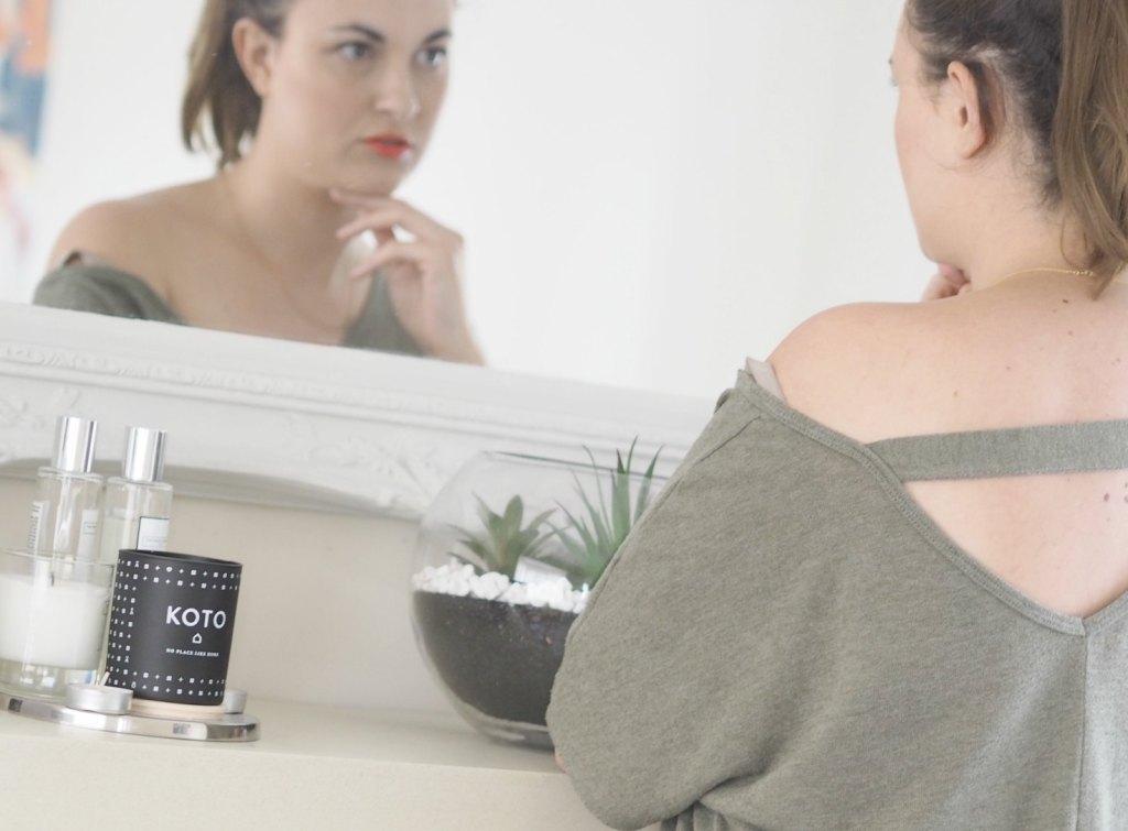 Blogger looking in mirror